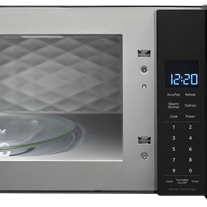 Four à micro-ondes à hotte intégrée Whirlpool, 1,1 pi³, noir