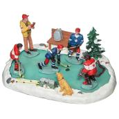 Figurines de village « Partie de hockey» en résine »