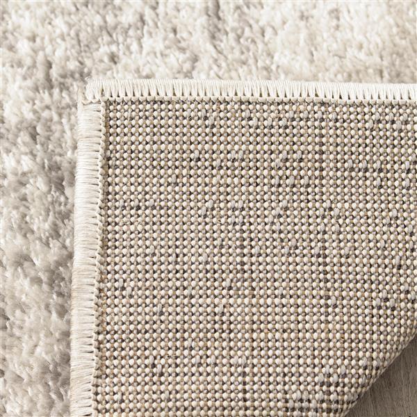 Tapis quatrefeuille Focus de Kalora, 7' x 10', gris pâle