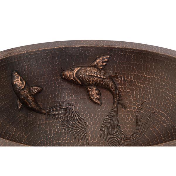 Évier en cuivre ovale avec poisons et robinet