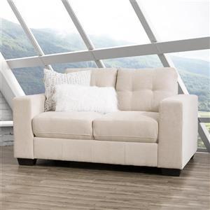 Petit canapé en tissu beige avec assise et dossier capitonné